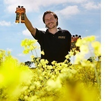 Yare Valley Rapeseed Oil in field with Glenn Sealey